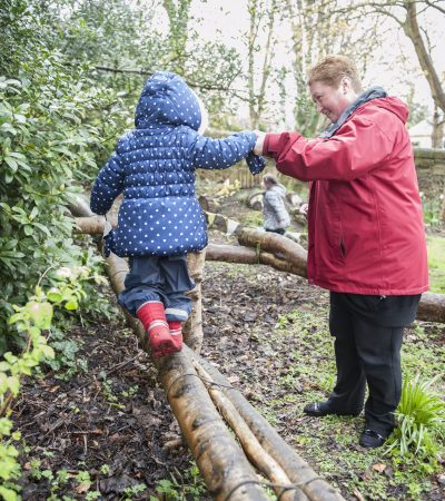 child on a balance log