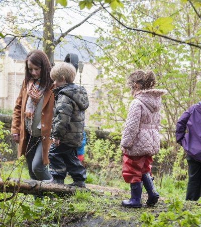 children and mum in wild woods